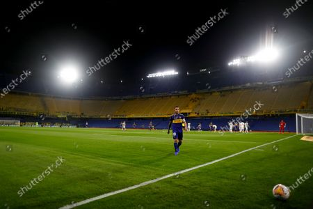 Carlos Tevez of Argentina's Boca Juniors walks on the field during a Copa Libertadores soccer match against Paraguay's Libertad in Buenos Aires, Argentina