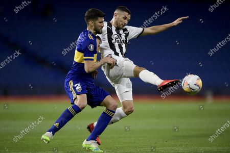 Adrian Martinez of Paraguay's Libertad, right, and Lisandro Lopez of Argentina's Boca Juniors battle for the ball during a Copa Libertadores soccer match in Buenos Aires, Argentina