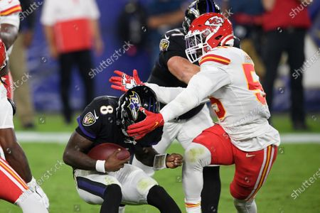 Stock Image of Baltimore Ravens quarterback Lamar Jackson (8) in action against Kansas City Chiefs defensive end Frank Clark (55) during the first half of an NFL football game against the Kansas City Chiefs, in Baltimore