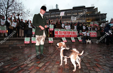 Stock Photo of Pro Hunting Demonstrators Outside The House Of Commons Today Before The Vote To Ban Hunting With Dogs. Matthew Higgs With Two Puppies From The South Herts Beagles.