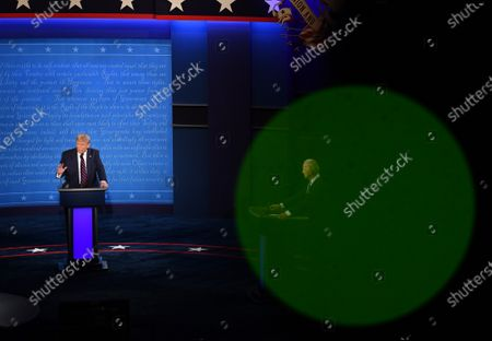 United States President Donald J. Trump (C) and Democratic presidential nominee former United States Vice President Joe Biden (R), with Chris Wallace moderating, face off in the first of three scheduled 90 minute presidential debates, in Cleveland, Ohio, on Tuesday, September 29, 2020.