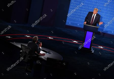United States President Donald J. Trump speaks with moderator Chris Wallace during the first of three scheduled 90 minute presidential debates with Democratic presidential nominee Joe Biden, in Cleveland, Ohio, on Tuesday, September 29, 2020.