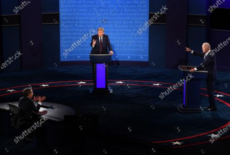 Stock Picture of United States President Donald J. Trump (C) and Democratic presidential nominee former United States Vice President Joe Biden (R), with Chris Wallace moderating, face off in the first of three scheduled 90 minute presidential debates, in Cleveland, Ohio, on Tuesday, September 29, 2020.