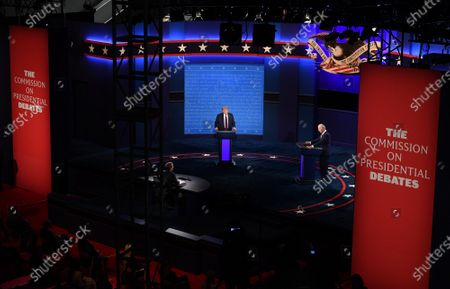 Stock Photo of United States President Donald J. Trump (C) and Democratic presidential nominee former United States Vice President Joe Biden (R), with Chris Wallace moderating, face off in the first of three scheduled 90 minute presidential debates, in Cleveland, Ohio, on Tuesday, September 29, 2020.