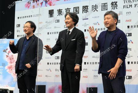 Japanese actor Koji Yakusho of the festival ambassador (C) poses for photo with film directors Koji Fukada (L) and Hirokazu Koreeda (R) at the line up presentation for the Tokyo International Film Festival 2020 in Tokyo on Tuesday, September 29, 2020. Tokyo International Film Festival 2020 will be held from October 31 through November 9.