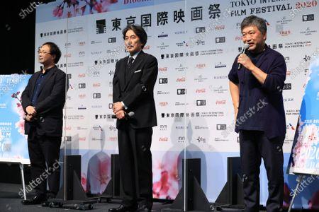 Japanese film director Hirokazu Koreeda (R) speaks while actor Koji Yakusho of the festival ambassador (C) and film director Koji Fukada (L) look on at the line up presentation for the Tokyo International Film Festival 2020 in Tokyo on Tuesday, September 29, 2020. Tokyo International Film Festival 2020 will be held from October 31 through November 9.