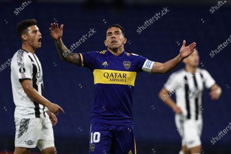 Carlos Tevez of Boca Juniors reacts (C) during a Copa Libertadores match between Boca Juniors and Libertad at La Bombonera stadium in Buenos Aires, Argentina, 29 September 2020.