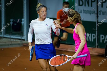 Stock Photo of Pauline Parmentier of France playing her last career match with Alize Cornet at the 2020 Roland Garros Grand Slam tennis tournament