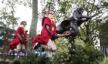 Stock Picture of A statue of Harry Potter is unveiled by Alex Zane in Leicester Square, joining Scenes in the Square, an illustrious trail of timeless movie characters and classic scenes from the past 100 years in London's home of film. The dynamic statue depicts Potter flying on his Nimbus 2000 in his debut Quidditch match from 'Harry Potter and the Philosopher's Stone' and is a free to visit attraction that will remain in London's home of film until at least summer 2023.