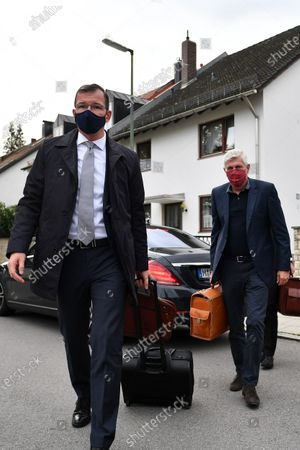 Former CTO of German carmaker Audi AG Wolfgang Hatz (R) arrives for a trial of the Volkswagen diesel scandal at the Stadelheim prison in Munich, Germany, 30 September 2020. German prosecutors filed charges against Stadler for fraud for the company's role in the diesel emissions scandal, also known as dieselgate. Stadler and three other defendants are accused of fraud, falsifying certifications and illegal advertising.