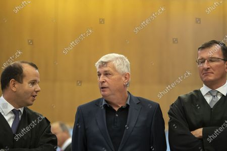 Former CTO of German carmaker Audi AG Wolfgang Hatz (C) and his lawyers arrive at the criminal trial of the Volkswagen diesel scandal in the courtroom at the Stadelheim prison in Munich, Germany, 30 September 2020. German prosecutors filed charges against Former CEO of German carmaker Audi AG Rupert Stadler for fraud for the company's role in the diesel emissions scandal, also known as dieselgate. Stadler and three other defendants are accused of fraud, falsifying certifications and illegal advertising.