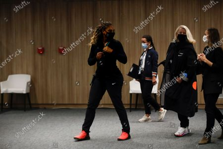 Serena Williams of the U.S., center, leaves after a video link press conference in which she announced her withdrawal from the tournament because of an Achilles injury prior to her second round match of the French Open tennis tournament at the Roland Garros stadium in Paris, France