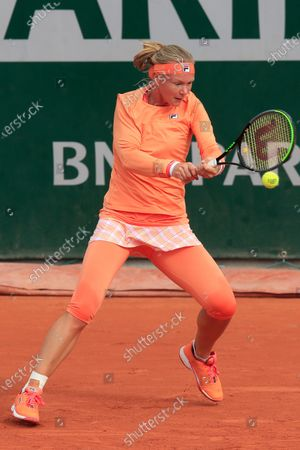 Stock Photo of Netherlands' Kiki Bertens plays a shot against Italy's Sara Errani in the second round match of the French Open tennis tournament at the Roland Garros stadium in Paris, France