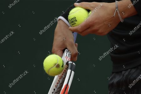 Austria's Dominic Thiem serves against Jack Sock of the U.S. in the second round match of the French Open tennis tournament at the Roland Garros stadium in Paris, France