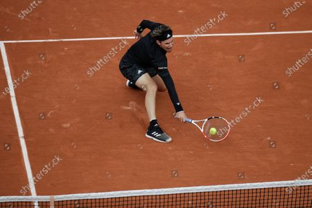 Austria's Dominic Thiem plays a shot against Jack Sock of the U.S. in the second round match of the French Open tennis tournament at the Roland Garros stadium in Paris, France