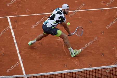 Jack Sock of the U.S. plays a shot against Austria's Dominic Thiem in the second round match of the French Open tennis tournament at the Roland Garros stadium in Paris, France