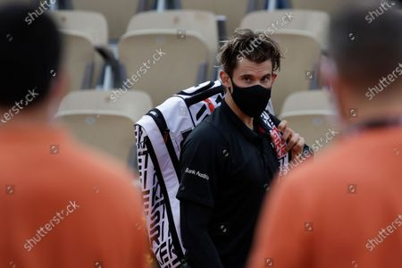 Austria's Dominic Thiem leaves after winning his second round match of the French Open tennis tournament against Jack Sock of the U.S. at the Roland Garros stadium in Paris, France