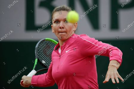 Romania's Simona Halep plays a shot against Romania's Irina-Camelia Begu in the second round match of the French Open tennis tournament at the Roland Garros stadium in Paris, France