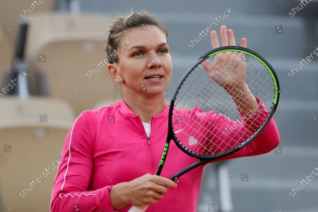 Romania's Simona Halep celebrates winning her second round match of the French Open tennis tournament against Romania's Irina-Camelia Begu at the Roland Garros stadium in Paris, France