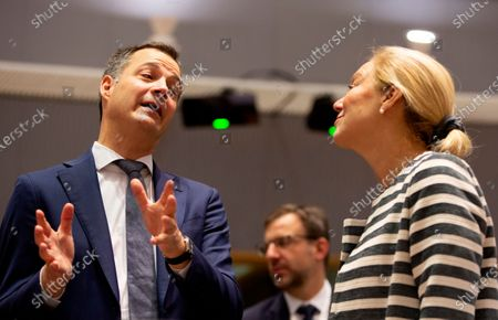 Dutch-speaking Liberal and Belgium's Minister for Development Alexander De Croo, left, speaks with Dutch Minister for Foreign Trade and Development Cooperation Sigrid Kaag during a meeting of EU foreign ministers at Europa building in Brussels. Almost 500 days after Belgian parliamentary elections, seven parties from both sides of the linguistic border have agreed on forming a fully functioning majority government that will center on dealing with the pandemic and its devastating economic impact