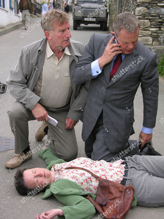 Malcolm Storry as Clive Tishell, Martin Clunes as Doc Martin and Georgie Glen as Barbara.