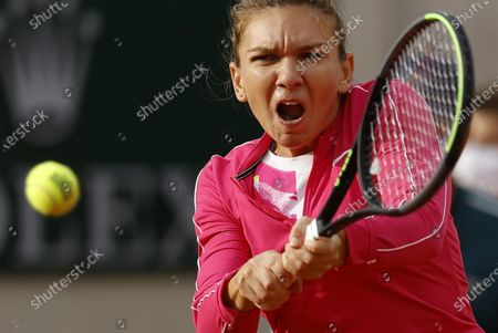 Simona Halep of Romania in action against Irina-Camelia Begu of Romania during their women's second round match during the French Open tennis tournament at Roland Garros in Paris, France, 30 September 2020.