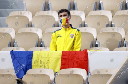 Romanian supporter watches Simona Halep of Romania in action against Irina-Camelia Begu of Romania during their women's second round match during the French Open tennis tournament at Roland Garros in Paris, France, 30 September 2020.