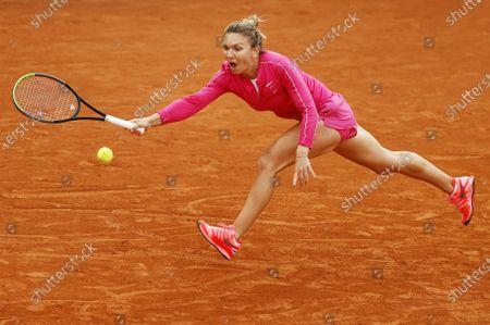 Simona Halep of Romania plays a forehand during her second round match against Irina-Camelia Begu of Romania at the French Open tennis tournament at Roland Garros in Paris, France, 30 September 2020