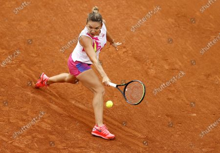 Simona Halep of Romania plays a backhand during her second round match against Irina-Camelia Begu of Romania at the French Open tennis tournament at Roland Garros in Paris, France, 30 September 2020.
