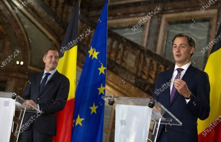 Belgian Minister of Cooperation Development and Finance, Alexander De Croo, right, and Belgian francophone Socialist Party chairman, Paul Magnette attend a media conference at the Egmont Palace in Brussels, . Almost 500 days after Belgian parliamentary elections, seven parties from both sides of the linguistic border have agreed on forming a fully functioning majority government that will center on dealing with the pandemic and its devastating economic impact