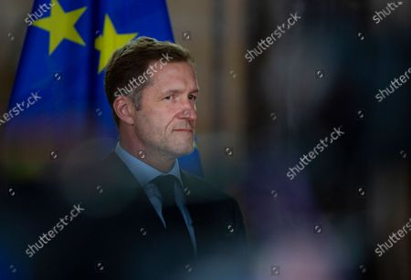 Belgian francophone Socialist Party chairman, Paul Magnette listens during a media conference at the Egmont Palace in Brussels, . Almost 500 days after Belgian parliamentary elections, seven parties from both sides of the linguistic border have agreed on forming a fully functioning majority government that will center on dealing with the pandemic and its devastating economic impact