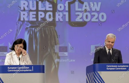 European Commissioner for Values and Transparency Vera Jourova, left, and European Commissioner for Justice Didier Reynders, participate in a media conference on the Rule of Law Report 2020 at EU headquarters in Brussels