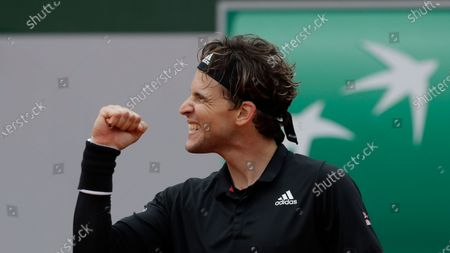 Austria's Dominic Thiem celebrates winning his second round match of the French Open tennis tournament against Jack Sock of the U.S. at the Roland Garros stadium in Paris, France
