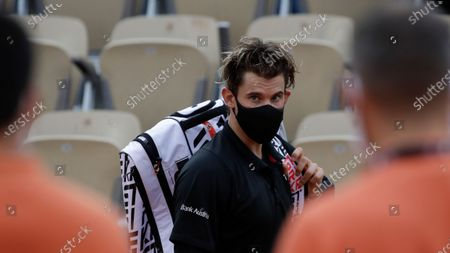 Stock Photo of Austria's Dominic Thiem leaves after winning his second round match of the French Open tennis tournament against Jack Sock of the U.S. at the Roland Garros stadium in Paris, France