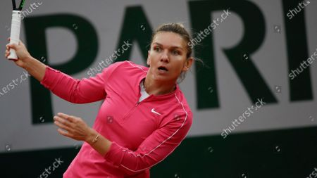 Romania's Simona Halep follows the ball in the second round match of the French Open tennis tournament against Romania's Irina-Camelia Begu at the Roland Garros stadium in Paris, France