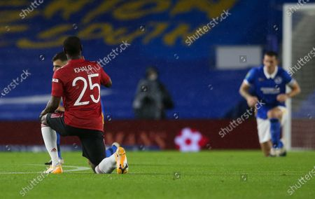 Stock Image of Odion Ighalo of Manchester United takes a knee