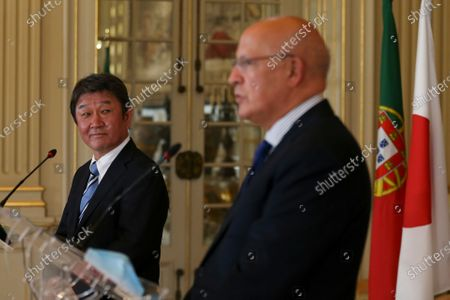 Japan's Foreign Minister Toshimitsu Motegi (L) looks on as his Portuguese counterpart Augusto Santos Silva (R) speaks during their joint press conference after a meeting at Necessidades Palace in Lisbon, Portugal, 30 September 2020.