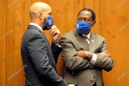 Stock Image of Rep. Royce Duplessis, D-New Orleans, left, speaks with House Democratic leader Sam Jenkins, D-Shreveport, ahead of the House and Governmental Affairs Committee meeting, in Baton Rouge, La. The committee discussed bills that would give lawmakers more oversight of the governor's emergency orders