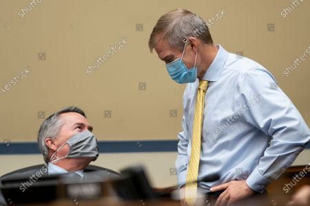 Stock Picture of Representative Tom Rice (R-SC), left, speaks with Representative Jim Jordan (R-OH), right, during a hearing before the US House of Representatives Committee on Oversight and Reform focused on the cost of prescription drugs at the US Capitol Building in Washington, DC, USA, 30 September 2020.