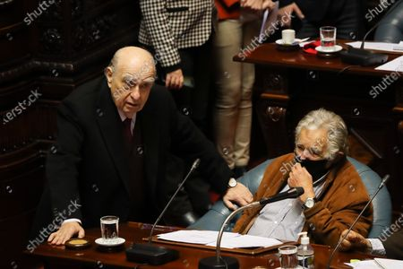 Former Uruguayan presidents and senators Julio Sanguinetti (L) and Jose Mujica (R), speak during a session in the Chamber of Senators, in Montevideo, Uruguay 30 September 2020. The Uruguayan Upper House faces this Wednesday the debate on the violation of Senator Guido Manini Rios, leader of the Cabildo Abierto (CA) and partner of the government coalition, for an alleged crime of omission in a case related to human rights, although not it has signs of prospering.
