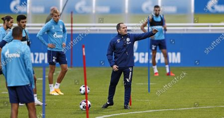 Manuel Baum, new head coach of Bundesliga soccer club FC Schalke 04, leads his first training session in Gelsenkirchen, Germany, . The German traditional club dismissed head coach David Wagner after a series of 18 consecutive winless matches last weekend. Former Brazilian defender Naldo is announced as new assistant coach