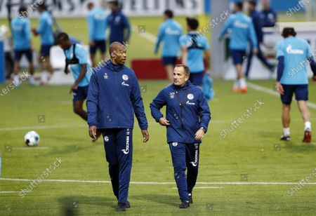 Manuel Baum, new head coach of Bundesliga soccer club FC Schalke 04, centre right, walks with new assistant coach Naldo, during their first training session in Gelsenkirchen, Germany, . The German traditional club dismissed head coach David Wagner after a series of 18 consecutive winless matches last weekend
