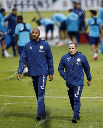 Manuel Baum, new head coach of Bundesliga soccer club FC Schalke 04, right, walks with new assistant coach Naldo, during their first training session in Gelsenkirchen, Germany, . The German traditional club dismissed head coach David Wagner after a series of 18 consecutive winless matches last weekend