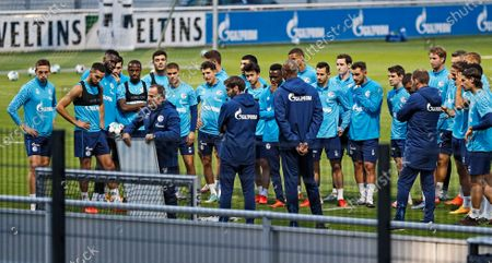 Manuel Baum, new head coach of Bundesliga soccer club FC Schalke 04, third left, holds a tactic board during his first training session in Gelsenkirchen, Germany, . The German traditional club dismissed head coach David Wagner after a series of 18 consecutive winless matches last weekend. Former Brazilian defender Naldo is announced as new assistant coach