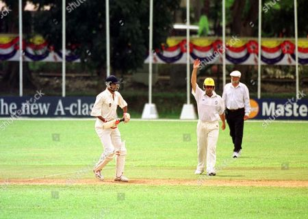 Stock Photo of ***16th Commonwealth Games In Kuala Lumpur 1998***commonwealth Games Kl. Australia Beat Canada At Cricket Wooldridge Special Australias Darren Lehman Signals The End Of Canadas Tom Moody In Deserted Ground