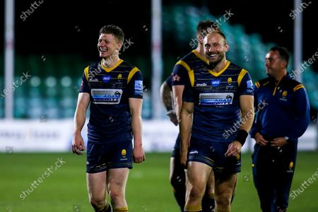 Noah Heward and Chris Pennell of Worcester Warriors celebrate after victory over Saracens