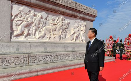 Xi Jinping walks around the Monument to the People's Heroes to pay tribute during a ceremony to present flower baskets to deceased national heroes at Tian'anmen Square in Beijing, capital of China, Sept. 30, 2020. Xi and other leaders of the Communist Party of China and the state including Li Keqiang, Li Zhanshu, Wang Yang, Wang Huning, Zhao Leji, Han Zheng and Wang Qishan joined representatives from various walks of life in the ceremony to mark Martyrs' Day on Wednesday morning.