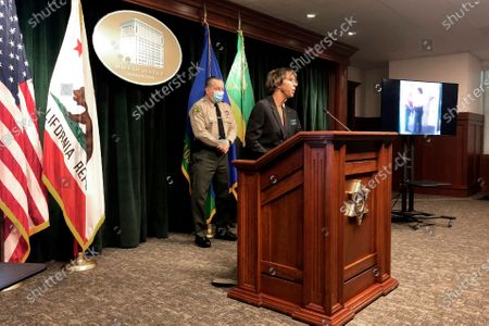 Los Angeles County District Attorney Jackie Lacey, right, and Sheriff Alex Villanueva announce the arrest of a man in connection with the shooting of two Los Angeles County sheriff's deputies at a news conference in Los Angeles . Lacy says attempted murder charges have been filed against Deonte Lee Murray. He was arrested two weeks ago in connection with a separate carjacking. The deputies suffered critical wounds in the Sept. 12 shooting which was recorded by surveillance video