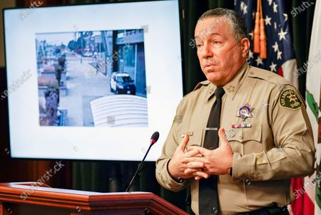 Los Angeles County Sheriff Alex Villanueva comments on the investigation of the shooting of two deputies during a news conference at the Hall of Justice in downtown Los Angeles. A photo from surveillance video of the assault is at left. Authorities say they have arrested a man in connection with the shooting of two Los Angeles County sheriff's deputies as they sat in their squad car. Villanueva and District Attorney Jackie Lacey on said attempted murder charges have been filed against 36-year-old Deonte Lee Murray. He was arrested two weeks ago in connection with a separate carjacking