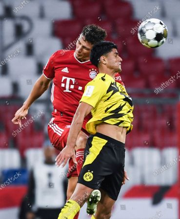 Bayern's Benjamin Pavard, left, and Dortmund's Mahmoud Dahoud head for the ball during the German Bundesliga Supercup soccer match between FC Bayern Munich and Borussia Dortmund in Munich, Germany